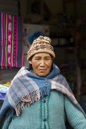 COPACABANA, BOLIVIA - JANUARY 8, 2018: Unindentified woman on the street of Copacabana, Bolivia.