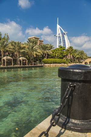 DUBAI, UAE - JANUARY 16, 2014: View of hotel Burj al Arab from Madinat Jumeirah in Dubai. At 321 m, it is the fourth tallest hotel in the world and has 202 rooms.