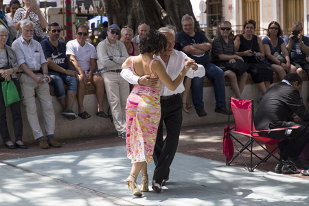 BUENOS, AIRES, ARGENTINA - JANUARY 21, 2018: Unidentified tango dancers on San Telmo flea market in Buenos Aires, Argentina. This street market takes place every Sunday morning.
