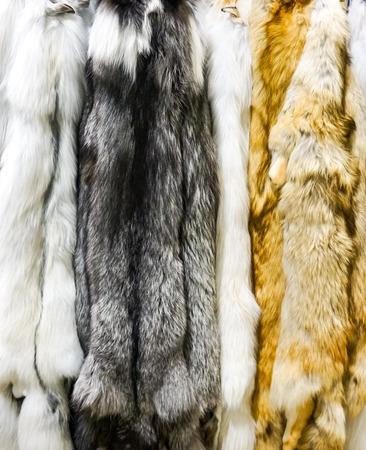 Closeup of the dark marble artic and red fox furs Foto de archivo - 96462690
