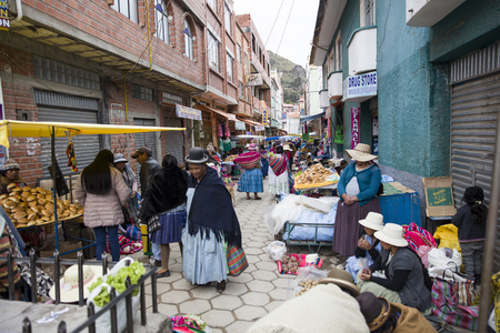 COPACABANA, BOLIVIA - JANUARY 9, 2018: Unindentified people on the street of Copacabana, Bolivia. Copacabana is the main Bolivian town on the Lake Titicaca