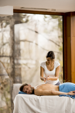 Young man having relax massage in the spa Archivio Fotografico - 96768569