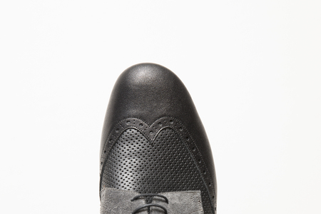Closeup detail of the male tango shoes