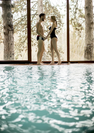 Loving couple relaxing in the spa center by the  pool Stock Photo