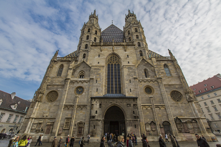 VIENNA, AUSTRIA - FEBRUARY 6, 2014: Unidentified people in front of St. Stephens Cathedral in Vienna, Austria. This Roman Catholic church was opened at year 1160.