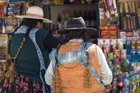 COPACABANA, BOLIVIA - JANUARY 6, 2018: Unindentified women on the street of Copacabana, Bolivia.