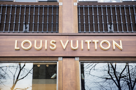 PARIS, FRANCE - JANUARY 24, 2018: View at Louis Vuitton shop in Paris, France. Louis Vuitton is French fashion house founded in 1854 and one of the world's leading international fashion houses