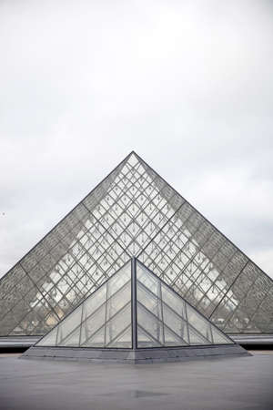 PARIS, FRANCE - JANUARY 24, 2018: View at Louvre Pyramid in Paris, France. Pyramid was completed in 1989 and become a landmark of the Paris