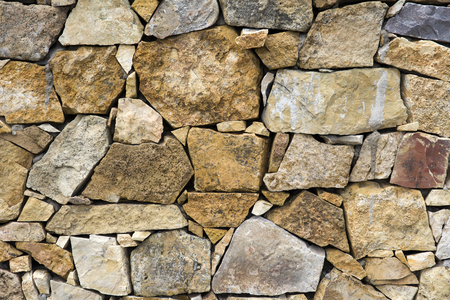 Detail of the old rustic stone wall backdrop