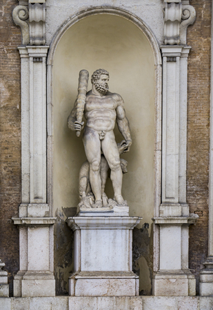 Statue of Hercules with a three headed dog at entrance of the Ducal Palace in Modena, Italy. Sculpure was made by Prospero Sogari at 1565. Stock Photo
