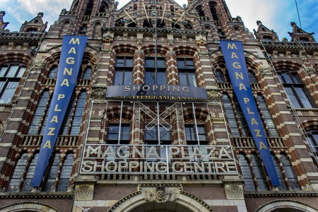 AMSTERDAM, HOLLAND - MARCH 6, 2018: View at Magna Plaza Shopping Centre in Amsterdam, Holland. Shopping mall is located in former Amsterdam Main Post Office, built in 1899.