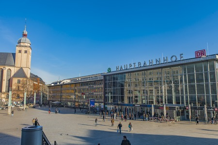 COLOGNE, GERMANY - FEBRUARY 28, 2015: Unidentified people by Cologne main station in Germany. It is an important local, national and international hub opened at 1859. Publikacyjne