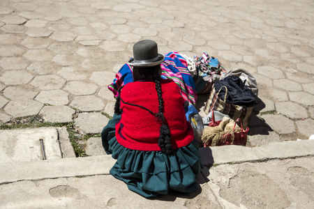 Unidentified woman at Titicaca lake in Bolivia.