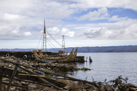 Traditional totora reed boat at Isla del Sol on Titicaca lake in Bolivia
