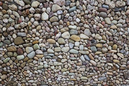 小石の石の道の背景のクローズアップ詳細