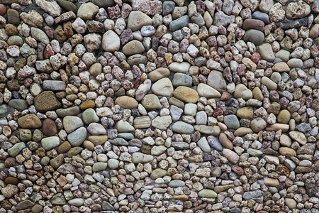 Closeup detail of the pebbles stone road backdrop