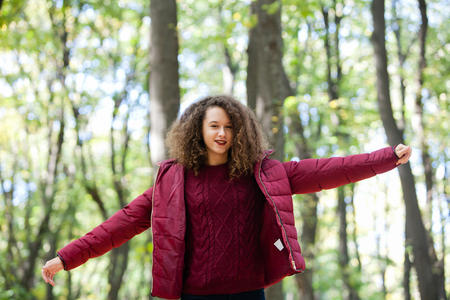 Pretty teen age girl in the forest Stock Photo