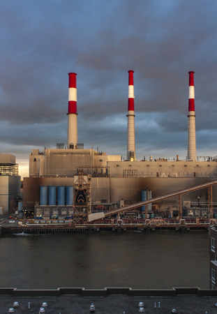 NEW YORK, USA - SEPTEMBER, 6, 2016: View at Ravenswood Generating Station on the East River in  New York, USA. It was built at 1965, and then was worlds largest steam energy generating facility