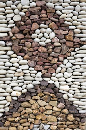 Closeup detail of the pebbles stone road backdrop