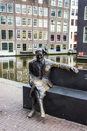 AMSTERDAM, NETHERLANDS - MARCH 6, 2018: Bronze sculpture of Alida Bosshardt (Major Bosshardt) in the Red Light District, Amsterdam, Netherland. Statue was made by by Peter de Leeuwe