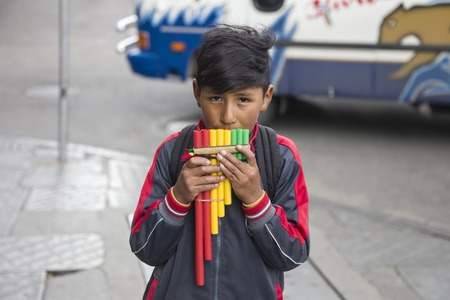 LA PAZ, BOLIVIA - JANUARY 12, 2018: Unidentified boy with pan flute at street of La Paz, Bolivia.
