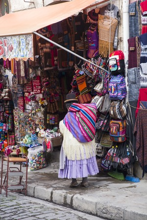 LA PAZ, BOLIVIA - JANUARY 10, 2018: Unidentified woman on the Witches market in La Paz, Bolivia. It is a popular tourist attraction located in Cerro Cumbre. Editorial
