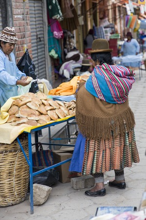 COPACABANA, BOLIVIA - JANUARY 6, 2018: Unindentified woman on the street of Copacabana, Bolivia. Copacabana is the main Bolivian town on the Lake Titicaca