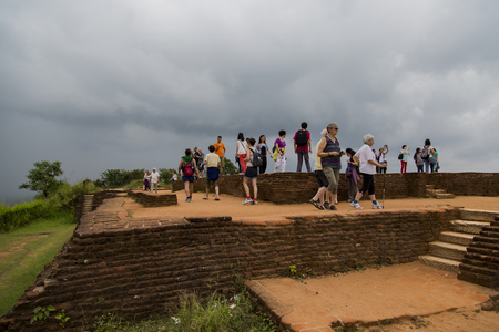MATALE, SRI LANKA- JANUARY 28, 2014: Unidentified tourists at Sigiriya Rock Fortress at Matale, Sri Lanka. Sigiriya today is a UNESCO listed World Heritage Site and most visited historic site in Sri Lanka.