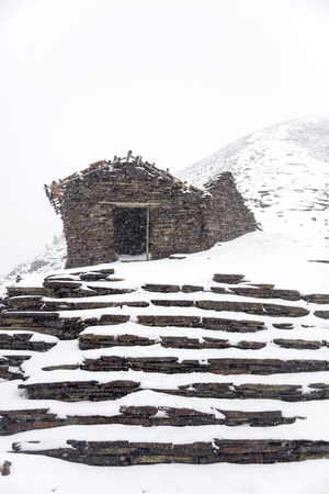 Ruined house at Chalcaltaya mountain in Cordillera range at Bolivia