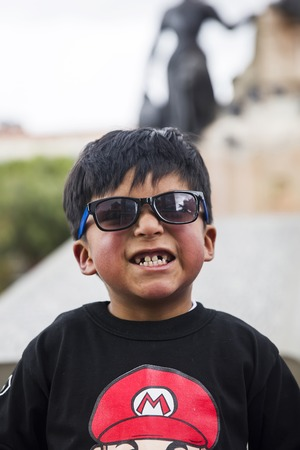 LA PAZ, BOLIVIA - JANUARY 12, 2018: Unidentified boy at street of La Paz, Bolivia. At an elevation of 3650 m La Paz is the highest capital city in the world
