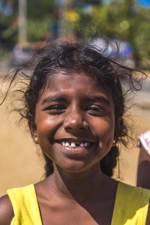 MATARA, SRI LANKA - JANUARY 25, 2014: Unidentified girl from Matara, Sri Lanka. Based on 2012 data, 24,9% population of Matara are younger of 14 years.