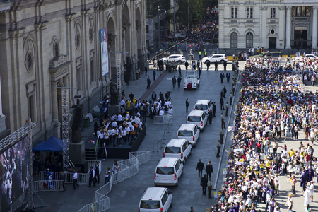 SANTIAGO DE CHILE, CHILE - JANUARY 16, 2018: Unidentified people on the street of Santiago de Chile during visit of Pope Francis. During his four day visit in Chile, Pope visited Santiago, Iquique and