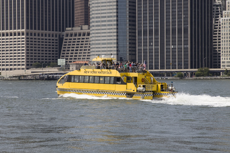 NEW YORK, USA - AUGUST 27, 2017: Boat of New York water taxi. water taxi service was founded at 20012 and now have  13 llines with 12 vessels mainly on East and Hudson River