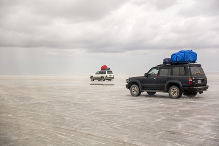 SALAR DE UYUNI, BOLIVIA - JANUARY 13, 2018: Expedition at Salar de uyuni in Bolivia. It is the worlds largest salt flat.