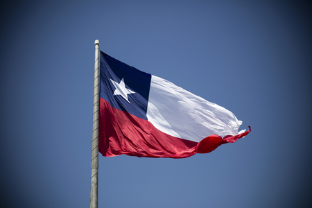 Chilean flag waving under blue sky