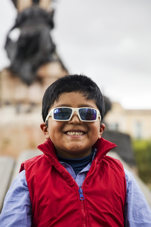 LA PAZ, BOLIVIA - JANUARY 12, 2018: Unidentified boy at street of La Paz, Bolivia.