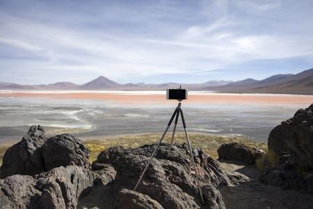 Mobile phone on the tripod by Laguna Colorada at Eduardo Avaroa Andean Fauna National Reserve in Bolivia
