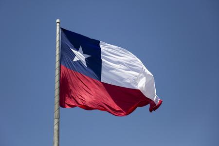 Chilean flag waving under blue sky