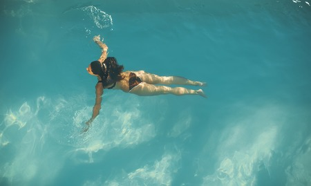 Top view at woman swimming in the pool