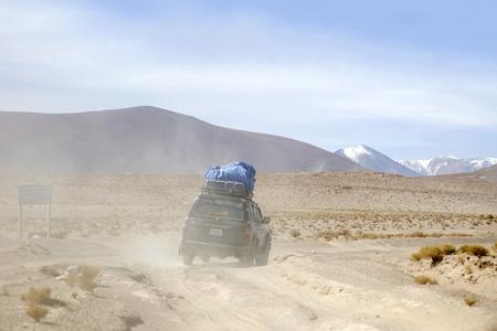 Terrain vehicle in Dali desert at Eduardo Avaroa Andean Fauna National Reserve in Bolivia Editorial