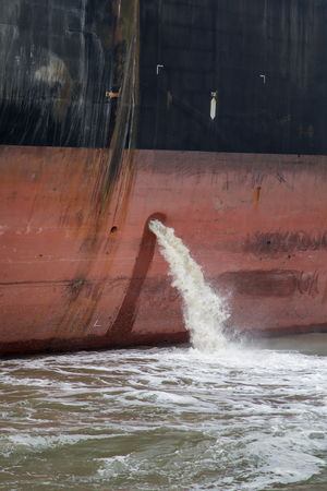 Closeup of the bilge water on the cargo ship
