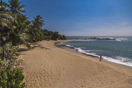 MATARA, SRI LANKA - JANUARY 25, 2014: Unidentified people on beach in Matara, Sri Lanka. Beaches at Matara are popular tourist destination in Sri Lanka.