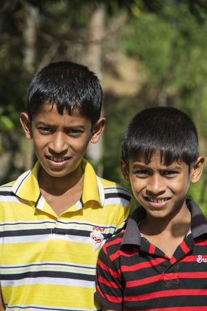 NUWARA ELIYA, SRI LANKA - JANUARY 25, 2014: Unidentified little boys on the street of Nuwara Eliya, Sri Lanka. In Nuwara Eliya live more than 43.000 people, mostly Sinhalese.
