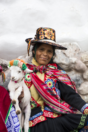CUSCO, PERU - DECEMBER 31, 2017: Unidentified woman on the street of Cusco, Peru. the Entire city of Cusco was designated a UNESCO World Heritage Site in 1983. Editorial