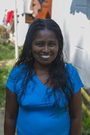 UNAWATUNA, SRI LANKA - JANUARY 23, 2014: Unidentified woman on the street of Unawatuna, Sri Lanka. Unawatuna is a major tourist attraction in Sri Lanka. Editorial