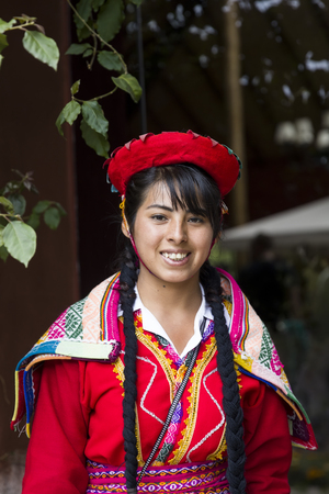CUSCO, PERU - DECEMBER 31, 2017: Unidentified young woman on the street of Cusco, Peru. the Entire city of Cusco was designated a UNESCO World Heritage Site in 1983. Sajtókép