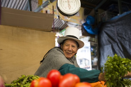 CUSCO, PERU - JANUARY 2, 2018: Unidentified woman on the San Pedro Market in Cusco, Peru. Markets play very important part of todays culture in Peru. 写真素材 - 99024194