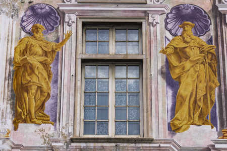 GENOA, ITALY - MARCH 3, 2018: Detail from Palazzo San Giorgio in Genoa, Italy. Palace was built in 1260 and facade was refrescoed in the late 19th century