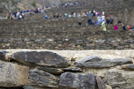 Tourists visiting Colossal Sanctuary of Ollantaytambo in Peru