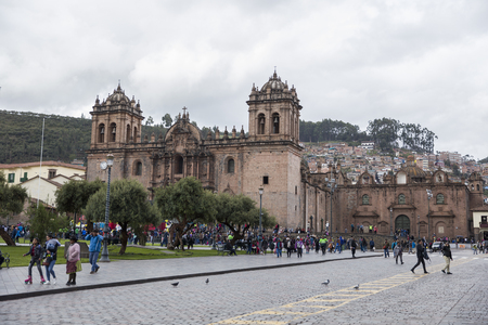 CUSCO, PERU - DECEMBER 31, 2017: Unidentified people on the street of Cusco, Peru. the Entire city of Cusco was designated a UNESCO World Heritage Site in 1983. Editorial